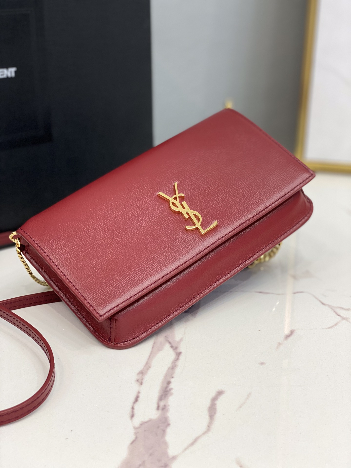 2020 cheap Saint Laurent monogram phone holder with strap in red smooth leather