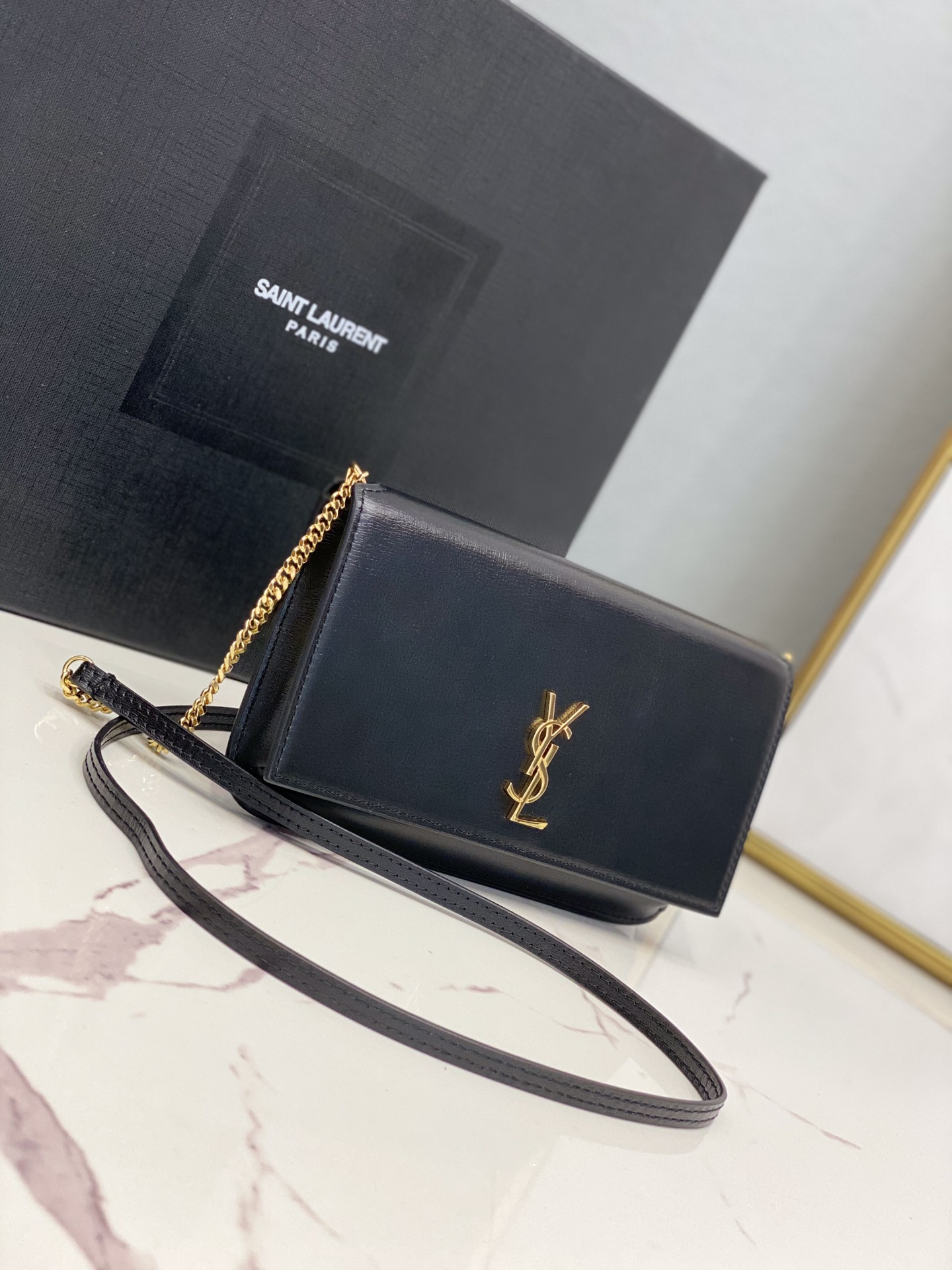 2020 cheap Saint Laurent monogram phone holder with strap in black smooth leather